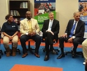 U.S. Attorney General Eric Holder (right) and Education Secretary Arne Duncan (second from right) recently chatted with students in Baltimore. (Courtesy photo)