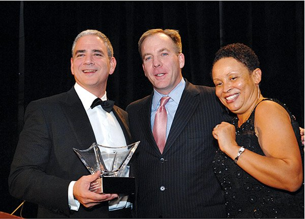 Dr. Ralph De La Torre (l), chairman and CEO of Steward Health Care, was the honoree at Harvard Street Neighborhood Health Center's Gifts of Health Gala/Fundraiser held at the Westin Copley Hotel. Joining De La Torre are HSNHC CEO Charley Murphy and Bonnie Brathwaite, chair of the center's board.