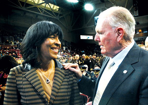 Former mayoral candidate Charlotte Golar Richie chats with former Boston Mayor Ray Flynn before the inauguration ceremony for new Boston Mayor Marty Walsh at Boston College's Conte Forum.