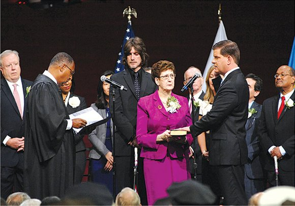 The new Boston and old Boston were in stark contrast Monday with the inauguration of Mayor Marty Walsh and a ...