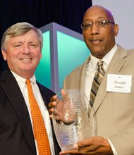 Greater Baltimore Committee CEO Donald C. Fry presents Center for Urban Families CEO Joseph T. Jones with the 2013 Walter Sondheim Public Service Award for his work to connect low-income urban men and women to career paths and strong family models.
