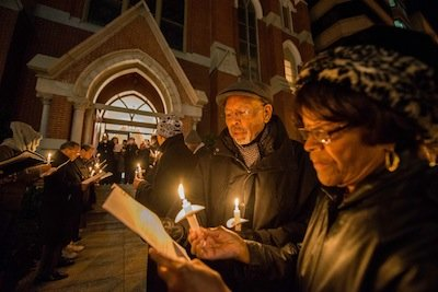Bob Bates and Delores Short participate in a candlelight vigil outside of the Metropolitan A.M.E. Church in Northwest D.C. after the National Youth Day of Action Against Gun Violence summit sponsored by National Action Network on Wednesday, Jan. 8.