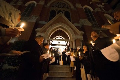 People gather for a candlelight vigil outside the Metropolitan A.M.E. Church in Northwest D.C. after the National Action Network-sponsored National Youth Day of Action Against Gun Violence summit on Wednesday, Jan. 8.