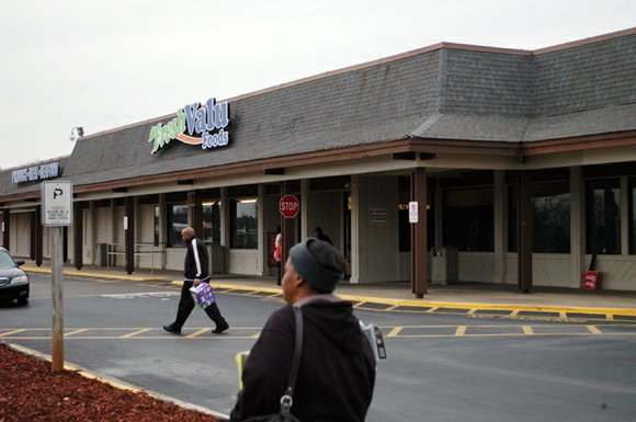 The old Kroger space in the Rainbow Village shopping center in Decatur is getting new life as Fresh Valu Foods.