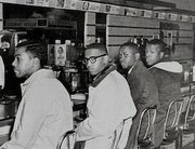 Franklin McCain (second from left) was one of four college students who staged a sit-in at a segregated lunch counter in North Carolina in 1960.