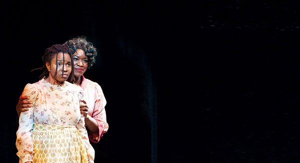 "Lovely Hoffman (l) as Celie and Crystin Gilmore (r) as Shug Avery in a scene from the SpeakEasy Stage Company musical adaptation of ""The Color Purple"" running through Feb. 8 at the Boston Center for the Arts."