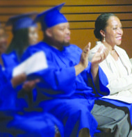 Lecester Johnson, Academy of Hope director, and graduates (Courtesy of Academy of Hope)
