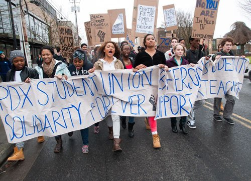Students from Jefferson High School in north Portland take to the streets on Friday to support teachers and avert a ...