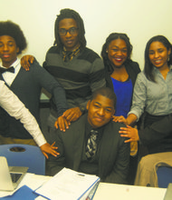 New York state Youth and College Division President Xavier Hutcherson, sitting, with NAACP Youth Board members