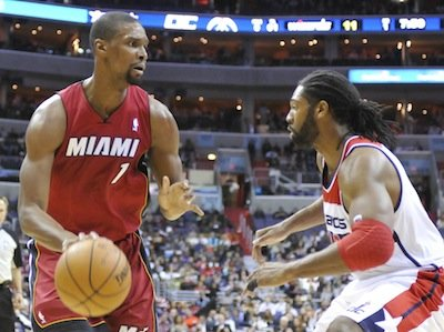 Miami Heat center Chris Bosh attempts to drive past Washington Wizards forward Nene at Verizon Center on Jan. 15. Wizards upset the defending NBA champion Heat, 114-97.