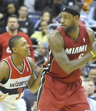 Miami Heat forward LeBron James posts up Washington Wizards guard Bradley Beal at Verizon Center on Jan. 15. The Wizards upset the defending NBA champion Heat, 114-97.