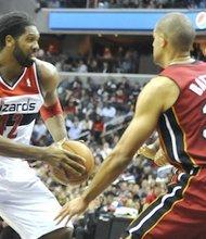 Washington Wizards forward Nene takes on Miami Heat forward Shane Battier at Verizon Center on Jan. 15. The Wizards upset the defending NBA champion Heat, 114-97.