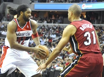 Washington Wizards forward Nene takes on Miami Heat forward Shane Battier at Verizon Center on Jan. 15. The Wizards upset the defending NBA champion Heat, 114-97.