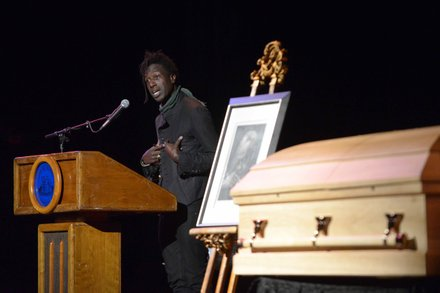 Poet Saul Williams reads a poem during the memorial services for Amiri Baraka on Saturday, Jan. 18 at the Newark Symphony Hall in Newark, N.J. Baraka died Jan. 9 of an undisclosed illness.