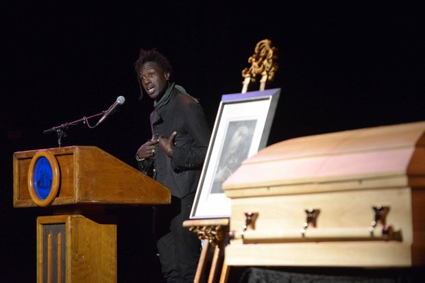 Poet Saul Williams reads a poem during the home-going services of poet Amiri Baraka on Saturday, Jan. 18, 2014, at the Newark Symphony Hall in Newark, N.J. Baraka died Jan. 9 of an undisclosed illness.
