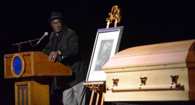 Actor Glenn Turman takes a final look at the casket of late poet Amiri Baraka as he offer remarks during the home-going services on Saturday, Jan. 18, 2014, at the Newark Symphony Hall in Newark, N.J. Baraka died Jan. 9 of an undisclosed illness.