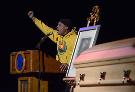 "Larry Hamm, founder of Peoples' Organization for Progress, gives the ""Black Power"" salute in honor of Amiri Baraka during the late poet's memorial service at the Newark Symphony Hall in Newark, N.J. Baraka died Jan. 9 of an undisclosed illness."