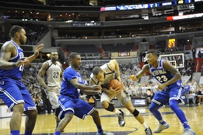 Georgetown guard Markel Starks drives between two Seton Hall defenders on Saturday, Jan. 18 at the Verizon Center in D.C. The Pirates defeated the Hoyas, 67-57.