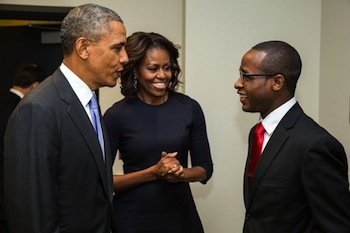 President Obama and first lady Michelle Obama greet Troy Simon, a student at Bard College, backstage prior to the College Opportunity Summit at the White House on Jan. 16, 2014. (Pete Souza/The White House)