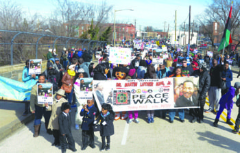 Hundreds of marchers participated in the annual peace walk to honor the work and the legacy of the Rev. Martin ...