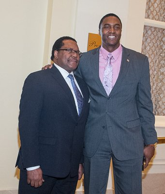 Ralph Everett (left), president and chief executive officer of the Joint Center for Political and Economic Studies with a guest attending the National Action Network King Day Breakfast at the Mayflower Hotel in Northwest on Monday, Jan. 20.
