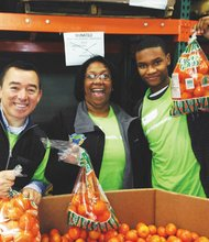 Kaiser Permanente employees Trevor Scott (from left), Sandra Howard and Tresean Foreman volunteer Monday at the Clark County Food Bank in honor of the Martin Luther King Jr. National Holiday and the late civil rights leader's legacy of compassion and dignity for the most vulnerable members of our community. Officials said more than 700 Kaiser employees, friends and family members volunteered at sites across the region, joining hundreds of other MLK Day of Service volunteers from the United Way and other organizations.