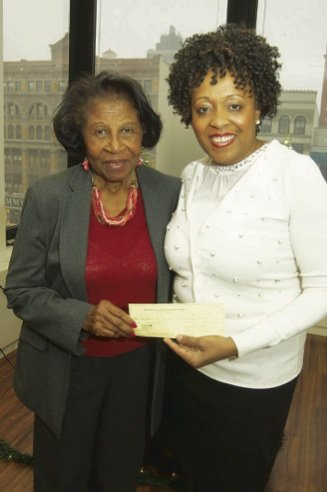 Friends of the Children of Lascahobas founder and President Estelle Dubuisson and Coalition President Avalyn P. Simon. Simon presented check of $1,000 to the Friends of the Children of Lascahobas on behalf of the Coalition of 100 Black Women (Gideon Manasseh photos)