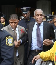 Danny Glover leaves the funeral.