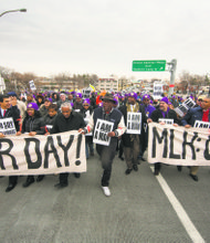 Airport workers and supporters protest on MLK day
