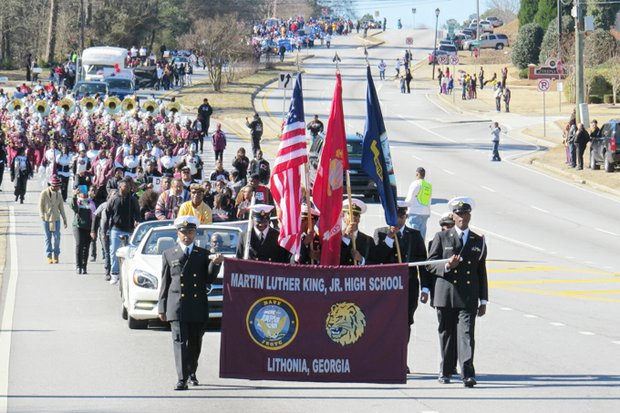 A color guard and cadets from Martin Luther King Jr. High participate in the parade along Flat Shoals Parkway and MLK Jr. Parkway.