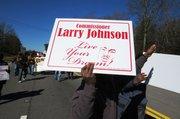 Commissioner Larry Johnson's entourage.