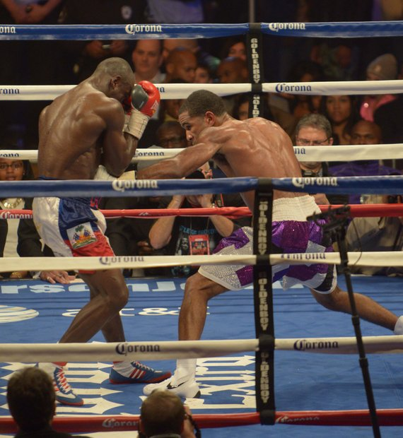 Junior welterweight champion Lamont Peterson lands a solid body punch in the 12th round on Saturday, January 25 at the D.C. Armory with over 5,550 in attendance. Peterson won the 12 round bout by way of decision.
