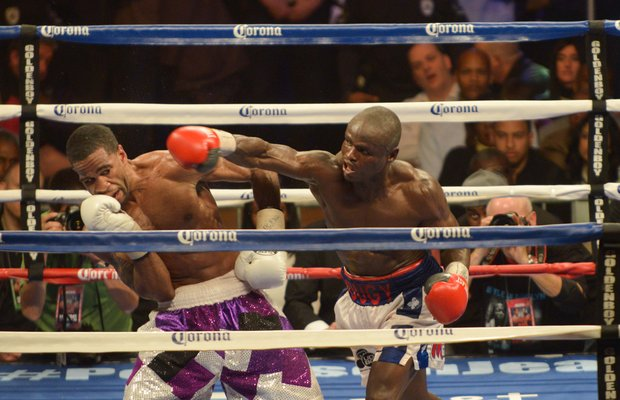 Junior welterweight champion Lamont Peterson dodges Dierry Jean punch in the 12th round on Saturday, January 25 at the D.C. Armory with over 5,550 in attendance. Peterson won the 12 round bout by way of decision.
