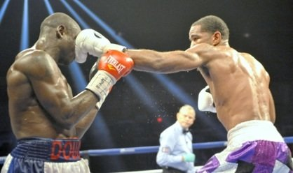 Lamont Peterson (purple trunks) won a unanimous decision over Dierry Jean to retain his IBF junior welterweight title at the D.C. Armory on Jan. 25.