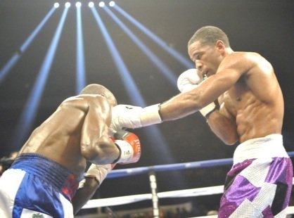"D.C.'s Lamont Peterson successfully defended his IBF junior welterweight championship Saturday with a 12-round unanimous decision over Dierry ""Dougy Style"" ..."