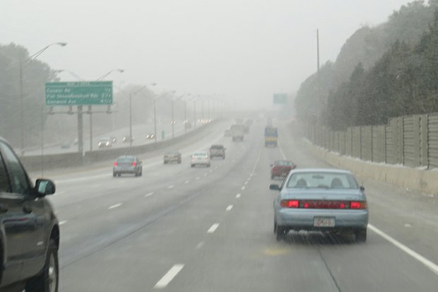 Traffic on I-20 flows as Tuesday at snow begins to fall on South DeKalb.