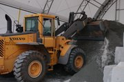Crews at DeKalb Roads and Drainage Division Jan. 28 mix sand and salt to be spread on streets to give drivers better traction in ice and snow.