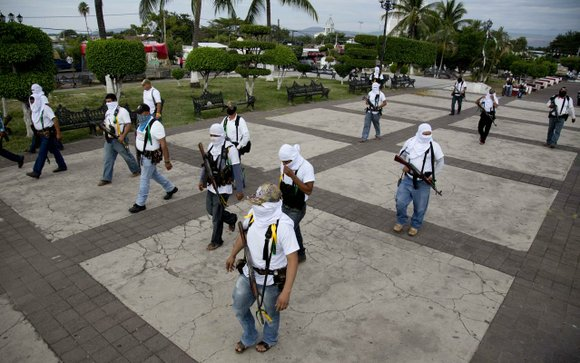 "Mexico essentially legalized the country's growing ""self-defense"" groups Monday, while also announcing that security forces had captured one of the ..."