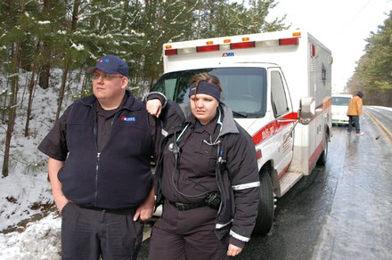 AMR paramedic David Singleton and emergency medical technician Christy Purcell had to wait for help from their company after their ambulance got stuck on Salem Road in Lithonia. The medics helped a stranded motorist who was suffering from diabetic complications.