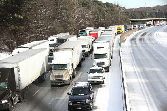 Thousands of motorists are still stranded on Atlanta roadways nearly 24 hours after snow snarled traffic. At noon today, tractor-trailers, ...