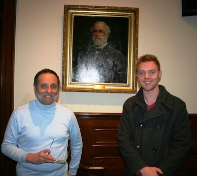 Dino Drudi (left), of Alexandria, and Sam Smith, a Civil War historian from D.C., stand in front of a painting of Gen. Robert E. Lee at the City Council Chamber in Alexandria, Va. The two men testified during a recent public hearing to discuss whether to stop naming new city streets after historic American people and places, and Confederate figures such as Lee.
