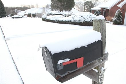 A snow-capped mailbox in Chapel Lake subdivision shows a quiet side of the snowfall that brought Atlanta traffic to a standstill.