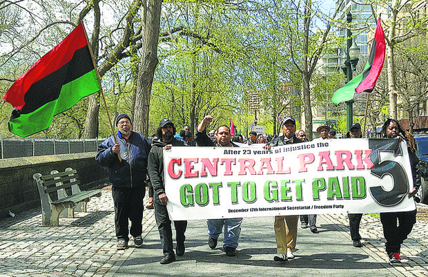 Community members protest for the Central Park 5