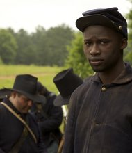 "Close-up of an African-American Union soldier in the field as seen in ""Civil War: The Untold Story."""
