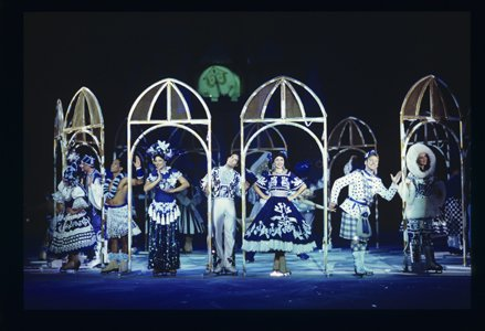 "Marsean Oyler (third from left) and other skaters performing in the Disney on Ice production ""100 Years of Magic."" Oyler portrays a band member in a Mickey Mouse routine and a soldier in a scene from Mulan. ""100 Years of Magic,"" which features 65 Disney characters, runs from February 5 through February 9, 2014 at the Baltimore Arena."