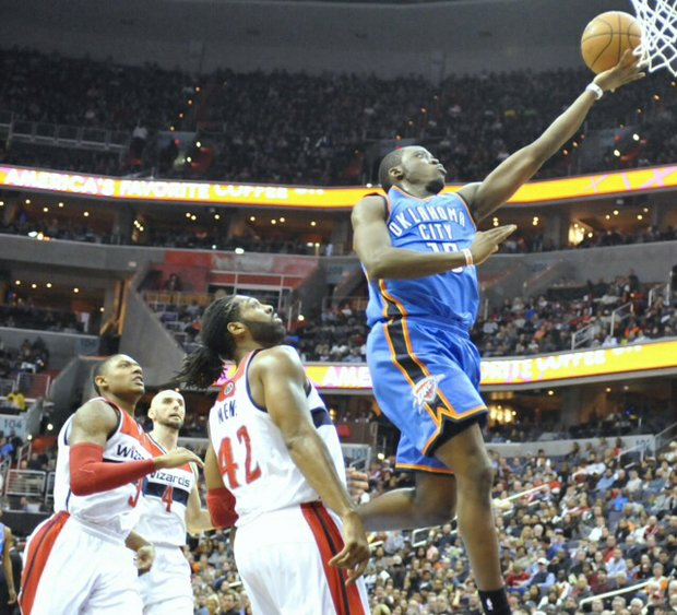 Oklahoma City point guard Reggie Jackson scores against the Washington Wizards on Saturday, Feb. 1 at Verizon Center in Northwest. The Wizards defeated Oklahoma City, 96-81, ending the Thunder's 10-game win streak.