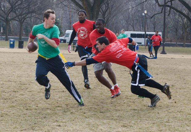 Chad B. eludes Steve Lanier during a flag football game on the National Mall in D.C. on Sunday, Feb. 2. The NAKID Winter Football League plays on the Mall on the weekends.