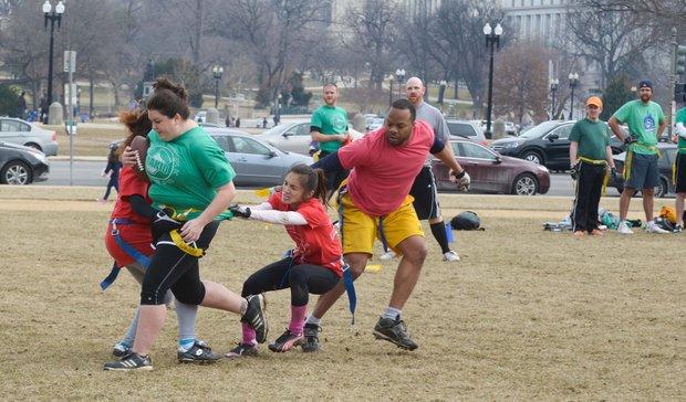 The NAKID flag football league enjoys an unusually warm day on the National Mall on Sunday, Feb. 2.