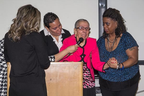 Regarded as one of the most noted female African American historians in the United States, Louise Daniel Hutchinson (center), extends thanks to the Academies at Anacostia during the dedication of her private book collection to the school on Tuesday, Feb. 4.