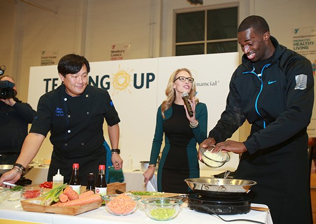 (l-r) Chef Ming Tsai with NESN's Dining Playbook producer and host Jenny Johnson and Boston Celtics forward Brandon Bass  and Assistant Coach Walter McCarty teamed up with Wes Thompson, President of Sun Life Financial U.S., and Kevin Washington, CEO of YMCA of Greater Boston, at a special community event designed to raise awareness of the critical risk factors associated with diabetes. NESN's Dining Playbook producer and host Jenny Johnson served as the event's emcee. The event officially kicked off Sun Life's commitment to preventing the disease, which includes a $250,000 donation to YMCA of the USA to support the national expansion of the YMCA's Diabetes Prevention Program. 